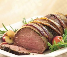 Beef fillet wrapped with bacon and herbs